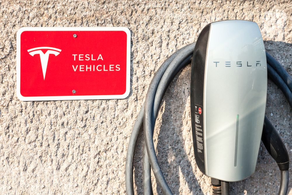BELGRADE, SERBIA - AUGUST 21, 2018: Logo of Tesla on their main charging station in Belgrade. Tesla specializes in electric vehicles, battery energy storage and solar panel manufacturing
